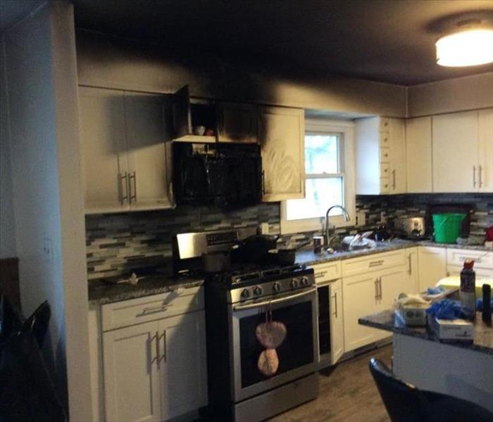 Picture of a Kitchen with smoke and fire damage