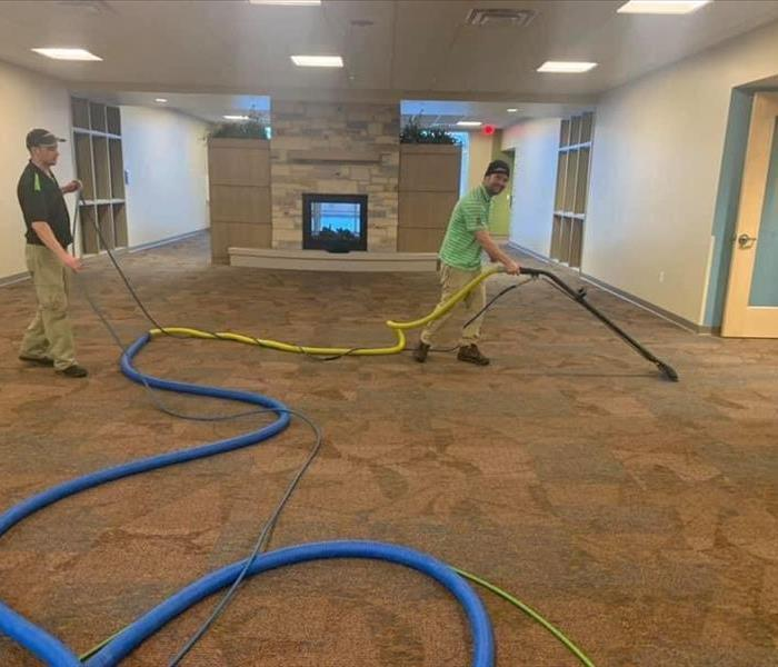 Picture of employees cleaning carpet
