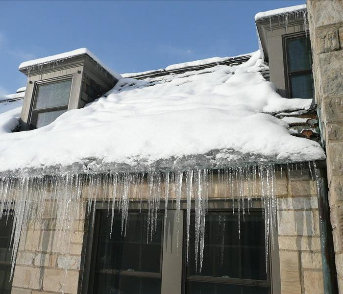 Picture of the outside of a home with roof damming